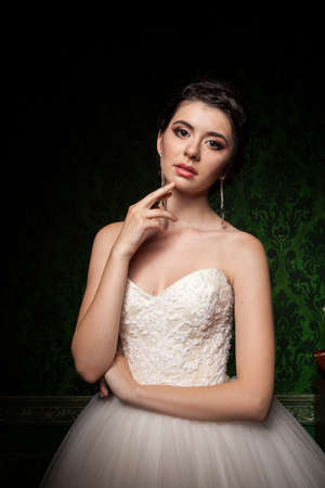 Gorgeous bride in green vintage interior. Happiness and marriage Stock Photo