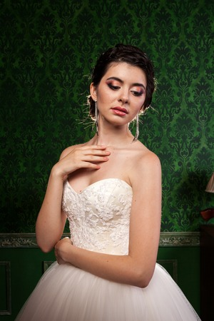 Sensual bride in vintage interior. Happiness and marriage