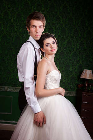 Beautiful bride and groom in green vintage interior. Happiness and marriage