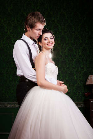 Beautiful inlove bride and groom in vintage interior. Happiness and marriage