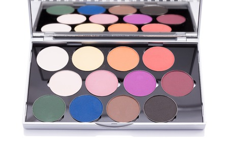 pallete: Eyeshadow of different colors over white background in studio photo. Beauty products