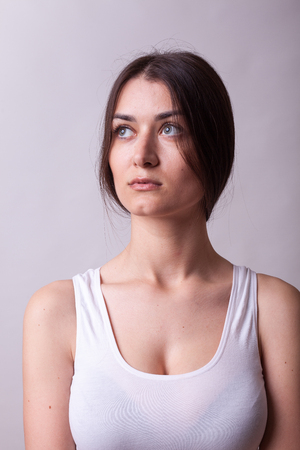 Portrait of beautiful woman wearing a white shirt. Sexy lady. Perfect beautiful attractive female posing in model test in studio Stock Photo