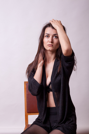 Sexy busty lady posing in fashion style on gray background. Sexy lady. Perfect beautiful attractive female posing in model test in studio