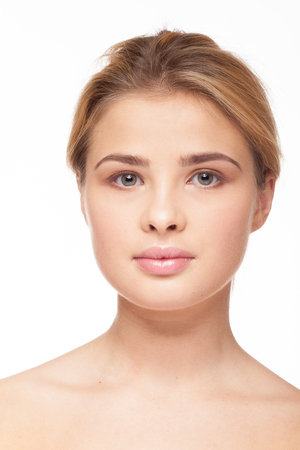Natural beauty of woman with no make up on white background in studio photo. Fresh clean look. Healthy skin Фото со стока