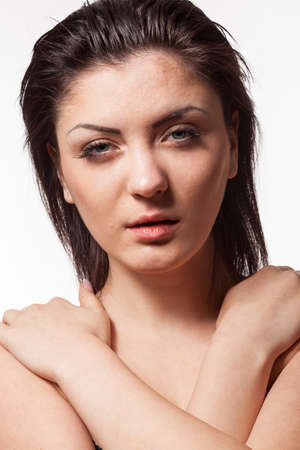 Portrait of woman in harsh studio light. Wet hairs. Studio posing Stock Photo