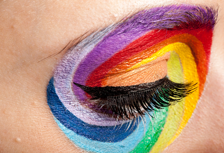 Eye with spinning rainbow colors. Close up Stock Photo