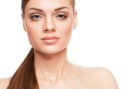Beautiful model with natural make-up on white background. Studio photo Stock Photo
