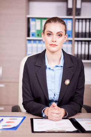 information analysis: Businesswoman sitting at her working desk in the office Stock Photo