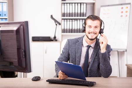 customer service representative: Smiling worker from Customer service support in the office. Professional online and telephone assistant support Stock Photo