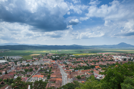 Landscape Panorama over a mountain city in the sping. Traveling and architecture