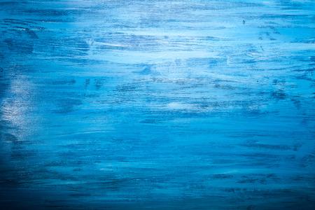 Fondo azul con color sobre fondo de madera. Fondo, textura y madera