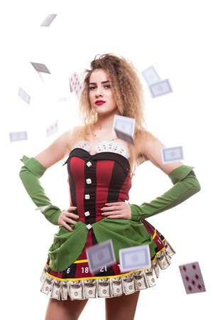 Conceptul image of beautiful entertainer girl in casino type outfit with playing cards falling all over the frame. Chance and risk. Gambling and winning Stock Photo