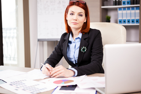 Businesswoman looking at the camera in her office Stock Photo