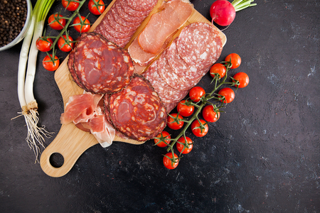 Top view on antipasto appetizers on wooden board Stock Photo