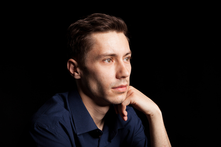 Portrait with fashion lighting of young man on black background Stock Photo