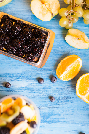 Top view of fresh mix of delicious fruits on wooden table. Healthy natural refreshment Reklamní fotografie