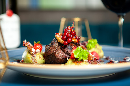 Fine dining Grilled steak with vegetables in restaurant, Professional gastronomy Stockfoto