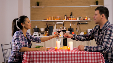 Young couple talking how their day was while having a romantic dinner. Happy couple