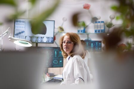 Portrait of middle age woman in a plant laboratory. Microbiological laboratory. Quality control.