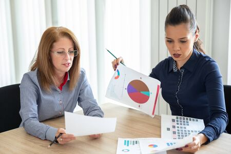 Two colleagues discuss the annual report. Office meeting Stock Photo
