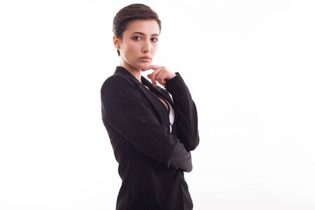 Attractive young woman in stylish black jacket posing over white background looking at the camera. Modern outfit.