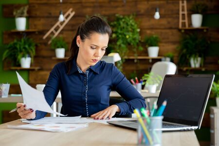 Businesswoman read the company report.Cozy office Stock Photo