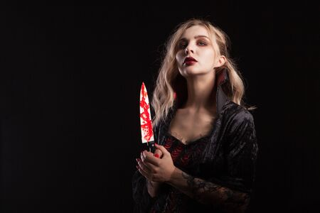 Portrait of sensual vampire woman dressed up for halloween carnival. Gorgeous vampire woman.