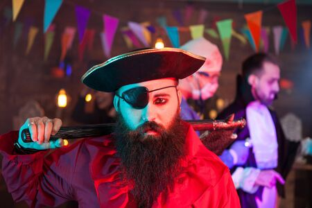 Portrait of handsome men dressed up like a sad pirate at halloween gathering. Attractive man in a pirate costume.