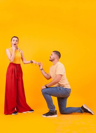 Boyfriend down on his knees asking girlfriend to marry him