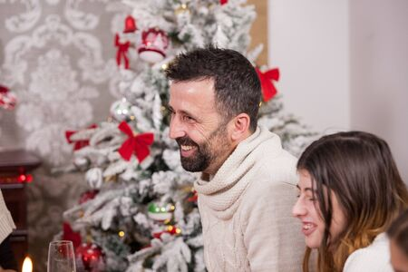 Portrait of smiling father and daughter at christmas feast. Traditional christmas decoration. Christmas tree. Family celebrating christmas. Banque d'images