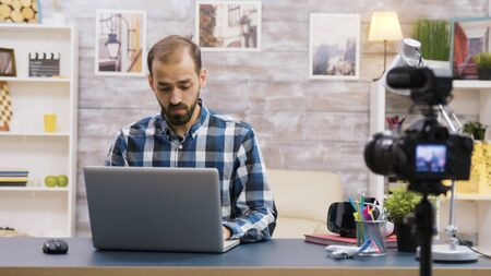 Creative content creator recording review of laptop. Famous vlogger.