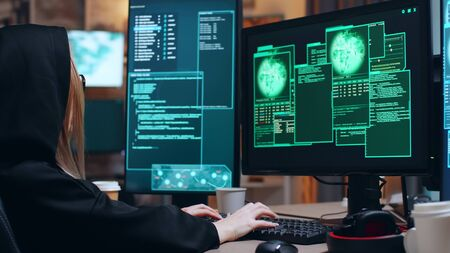 Organized female hacker and her team stealing information from government server using super computers. Stockfoto