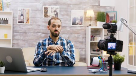 Caucasian vlogger recording a podcast for social media.