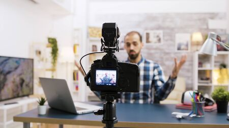 Young and cheerful vlogger recording for subscribers. Stockfoto