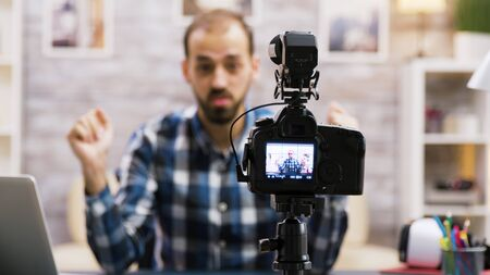 Creative young man talking in front of camera. Zoom in shot effect.