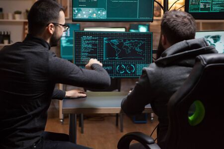 Team of hackers planning a cyber attack using a dangerous malware.