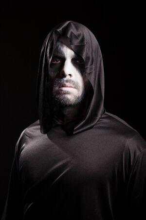 Creepy man dressed up like grim reaper for halloween.
