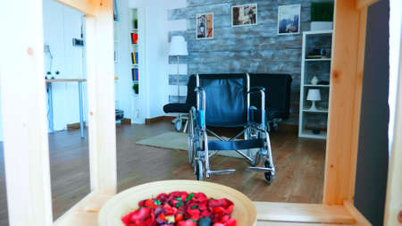 Wheelchair for people with handicap mobility in a room with nobody in it.