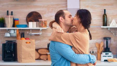 Charming married couple full of happiness dancing in kitchen. Cheerful happy young family together dance. Fun love affection romance leisure romantic music for enjoynment