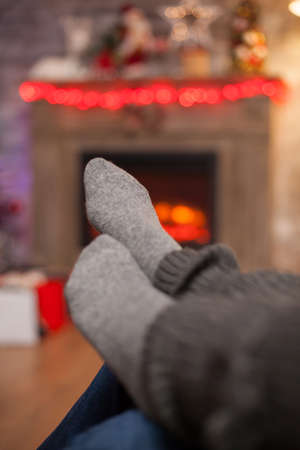 Pair of girlfriend feet in front of fireplace