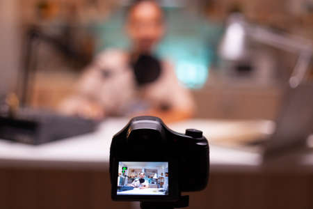 Influencer sitting at vlog station while camera is recording.. Creative online show On-air production internet broadcast host streaming live content, recording digital social media communication Фото со стока