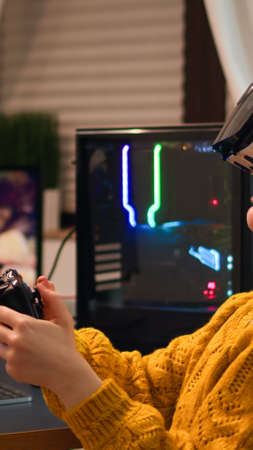 Pro cyber sport gamer relaxing playing video games using vr headset late night. Virtual shooter game championship in cyberspace, esports player performing on pc during gaming tournament