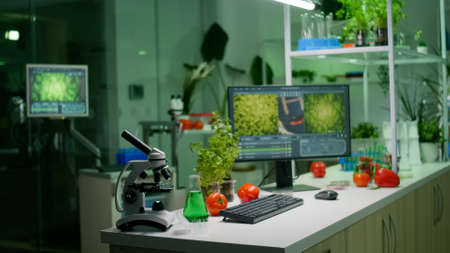 Empty microbiology laboratory with nobody in it equipped with professional equipment prepared for biological innovation using hight tech tools for scientific biochemistry research Stockfoto