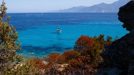 Seascape of Corsica, France, mountains horizon background. Horizontal view