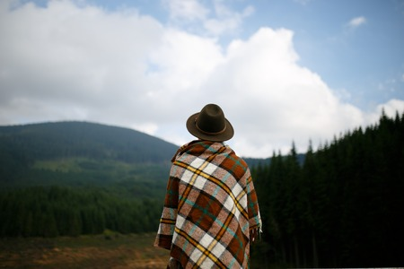 A man admisring a Carpathians landscape. Transalpina, Romania Horizontal outside shot. Фото со стока