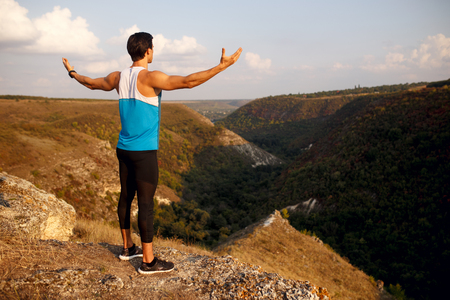 Back of a sportsman, muscular, fit, abs, sportive young man Summer landscape. Copy space.