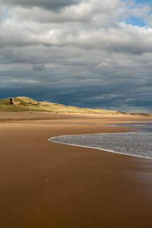 View of waves hitting Balmedie beach on a cloudy day, Aberdeenshire
