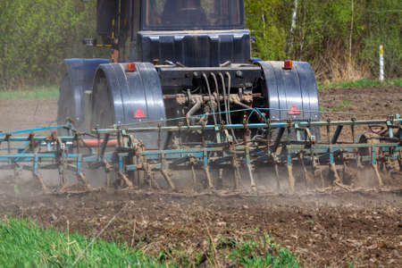 cultivating: Tractor cultivating the field