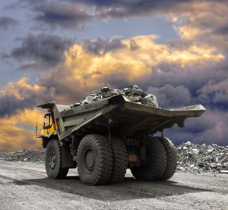 dump truck: Heavy mining truck driving along the opencast
