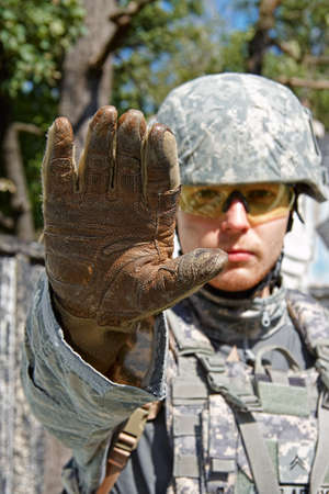 acu: Soldier showing arm and orders you to stop doing something